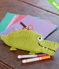 http://www.yarnspirations.com/pattern/crochet/alligator-pencil-case