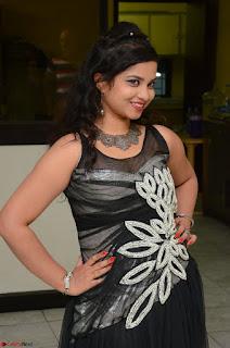 Shrisha Dasari in Sleeveless Short Black Dress At Follow Follow U Audio Launch 045.JPG