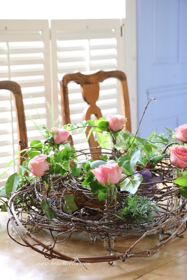 Spring celebration grapevine bird nest centerpiece with fresh flowers