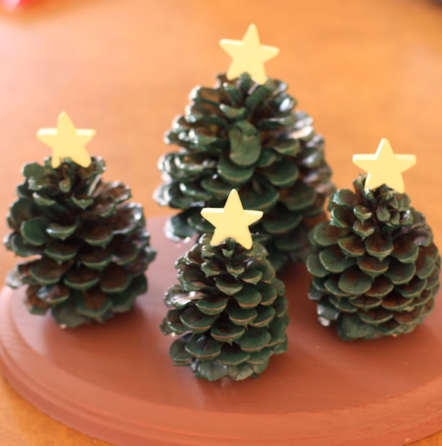 Kids 39 craft pine cone christmas tree village decoration for Crafts using pine cones