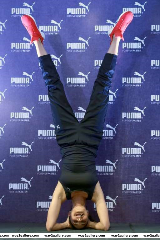 Jacqueline Fernandez does a headstand during the launch of Pumas flagship store in New Delhi