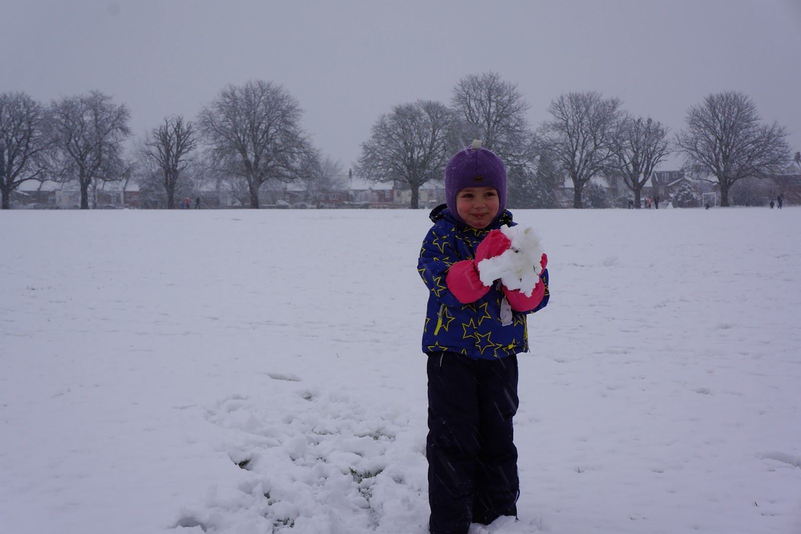 girl making a snowball