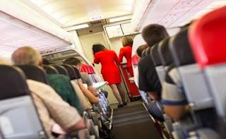 Naik pesawat pilih kursi dekat jendela atau lorong?