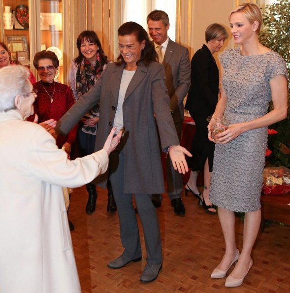 Prince Albert and Princess Charlene then handed out beautiful gifts to the 97 little ones