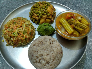 Hand pounded parboiled rice, Drumstick sambhar, Cabbage Carrot Beans poriyal, Green peas Potato poriyal, Mint Chutney