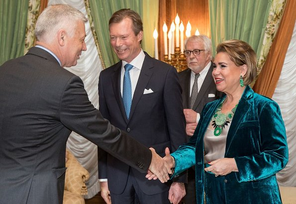 Grand Duke Henri and Grand Duchess Maria Teresa. Maria Teresa is wore greenvelvet suit. Princess Stephanie
