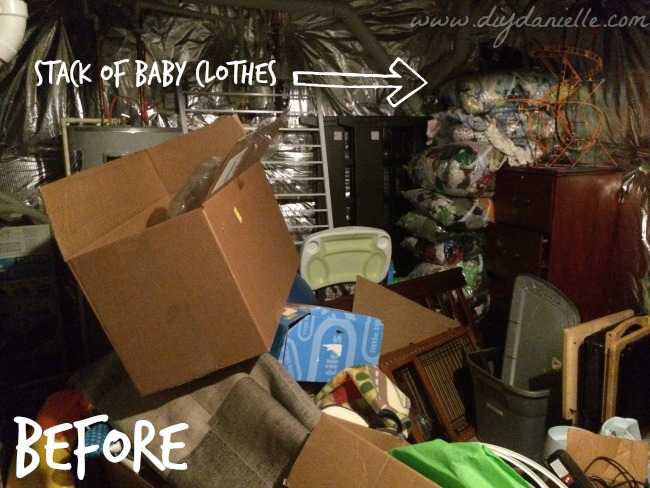 Our basement storage area before getting rid of baby items!