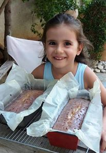 My sweet Granddaughter with my lemon drizzle cake Why make one when you can make two? Photo- Greeker than the Greeks