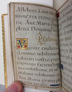 An open book with illuminated details.