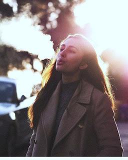 teen smoking exhale