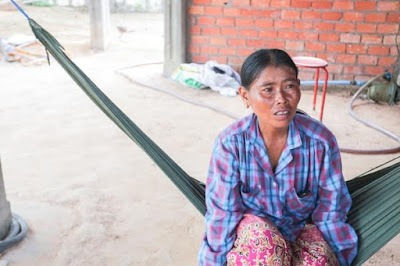 Heum Hort, whose husband is in custody over the shooting of Kem Ley, sits in a hammock at her house in Siem Reap's Angkor Chum district. KT/ Mai Vireak