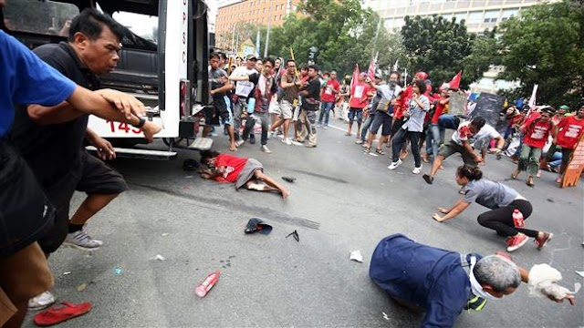 Police van rams into anti-US protesters in Philippine capital, Manila