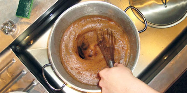 stirring wort with a whisk