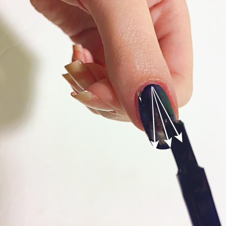Painting a layer of nail polish onto a nail