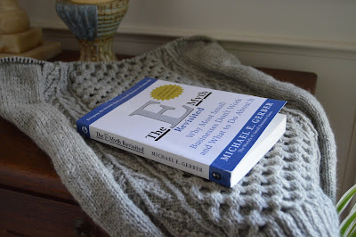 knitting a honeycomb sweater and reading a book called The E Myth