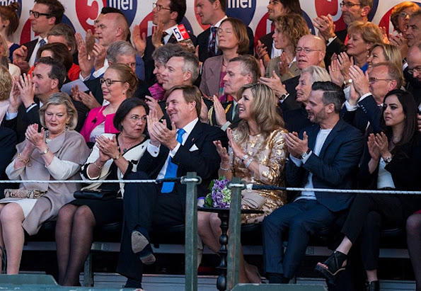 Queen Maxima and King Willem attends the Liberation Day Concert. Queen Maxima wore Jimmy Choo Tilly Metallic Pumps and Natan dress