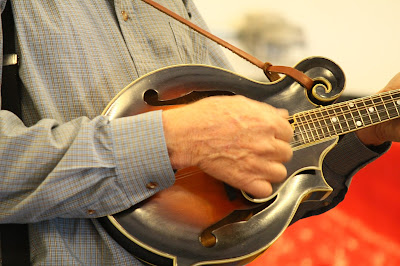 mandolin being played by gray shirt player