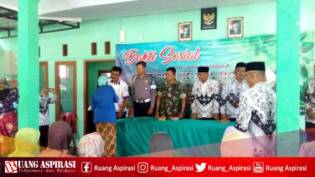 Bakti Sosial HUT PGRI ke 73 dan HGN ke 25 UPTD Kecamatan Sumbermalang - Situbondo