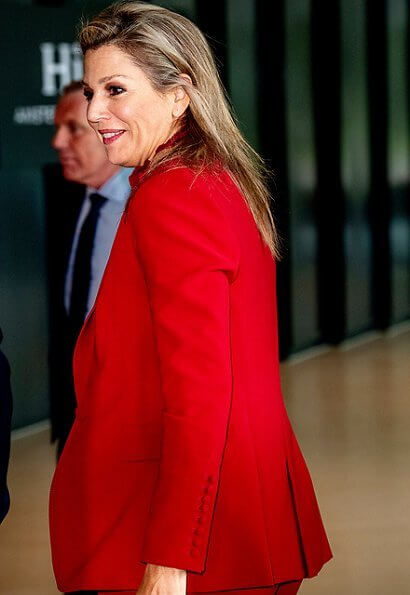Queen Maxima wore Claes Iversen LaPerm classic blazer and Lykoi trousers and Korat silk blouse. she carries Chanel red bag