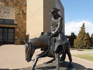 cowboy and his horse sculpture