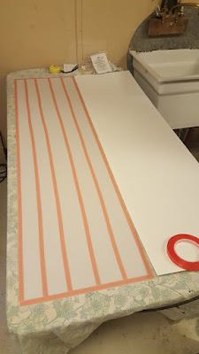 Double-stick tape being used to apply the polycarbonate backing sheets.