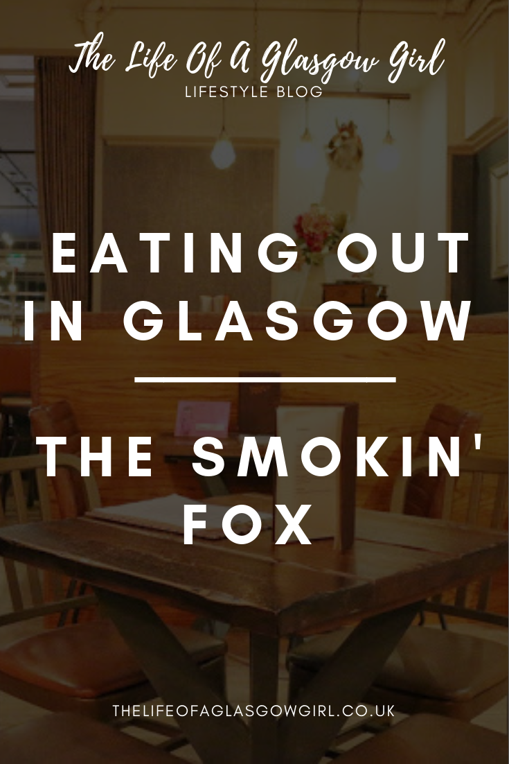 Pinterest Graphic for Blog post on The Smokin Fox in Glasgow. A close up of a table area within the restaurant with a table and two chairs