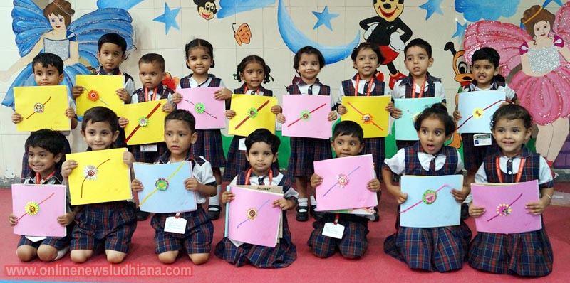 Students shows Rakhi during Raksha Bandhan celebrations at Green Land Convent School