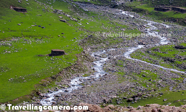 Peer Ki Gali is an amazing place on old Mughal road in Jammu & Kashmir State of India. This place is the highest passes on Srinagar Rajouri historic Mughal Road at 11300 Feets... Let's check out this Photo Journey to know more about this place with appropriate photographs...Various water streams can seen flowing through snow covered peaks of Peer-Ki-Gali hills. Cool freeze, freshening environment and roaming clouds all over makes this place wonderful. After talking to various folks at Peer ki Gali, we got to know that almost every day it rains on these hills. We spent two days around it and we also experienced rain showers both the days...Here is a photograph of a shopkeeper inside his small shop made up of stones. He had almost everything that is usually required for routine life in hills. These families come to these high hills with their cattle, as this place has got more than enough grazing land which becomes a problem during a particular time of the year. Ziarat of Peer Baba on hill top has gained its popularity. Almost every vehicle passing by Peer-ki-Gali stops here to enjoy the panaromic view as well as to take blessings of Peer Baba. Green layer on Peer-Ki-Gali hills looks amazing and it's a huge range of hills with green meadows...Shepherd sitting in these green hills around Peer ki Gali... Almost every alternate hill was full of sheeps and horses... This trend was only noticed around Peer-Ki-Gali on Mughal Road...In past this place have been of great interest for trekkers and now easily accessible for others as well. Tourism is picking up in this region of Jammu and Kashmir now. This will not only boost the economy of the state but also open new aspects to the residents.CRPF folks can seen here and there around these hills to make every person safe on these hills around Peer ki Gali. Really these folks are working really well to give confidence to common people to enjoy the beauty around Mughal Road.Sheeps all around in green hills of Peer Ki Gali, Kashmir, India.All these water streams make the whole environment more beautiful. All these streams have chilling water of melted snow of hill-tops. Dark clouds covering blue sky with lush green hills having multiple white-water streams - this whole combination makes Peer-Ki-Gali a unique place.Local folks on this stretch can organize various trekking trips with all arrangements for lodging in tents or some othe wooden houses, which can good source of income going forward.Jammu and Kashmir state of India is known as heaven on earth. In the seventeenth century the Mughal emperor Jahangir set his eyes on the valley of Kashmir and Peer-Ki-Gali is one of the place they used to stay. There is an old Mughal Residence in deep valley. Mughals said that if paradise is anywhere on the earth, it is here, while living in a houseboat on the mesmerizing Dal Lake.  In Jammu and Kashmir the most important tourist places are Kashmir, Srinagar, the Mughal Gardens, Gulmarg, Pahalgam, Jammu, and Ladakh...It will take a long more time to further develop the area but nobody can deny that it's magical. This whole stretch is magnetic. It draws you closer and closer. As we packed up, the beauty of the place wanted me to linger more. But I returned home with some amazing memories to cherish forever; vivid pics in the heart and mind that won't fade or get lost ever. It is a place that can't be expressed in words and that can't be explained in pics; just plan a trip and experience it all yourself.Before militancy intensified in 1989, tourism formed an important part of the Kashmiri economy. The tourism economy in the Kashmir valley was worst hit. Many five stars in Srinagar can be seen which are not well maintained now and owners can't afford to spend more on those properties. However, the holy shrines of Jammu and the Buddhist monasteries of Ladakh continue to remain popular pilgrimage and tourism destinations. Every year, thousands of Hindu pilgrims visit holy shrines of Vaishno Devi and Amarnath which has had significant impact on the state's economy.The Vaishno Devi yatra alone contributes Rs. 450+ crores to the local economy annually.Tourism in the Kashmir valley has rebounded in recent years and in 2009, the state became one of the top tourist destinations of India. Gulmarg, one of the most popular ski resort destinations in India, is also home to the world's highest green golf course. However with the decrease in violence in the state has boosted the states economy specifically tourism.Peer ki gali has religious importance as well. Most of the folks crossing through this place, stop by and spend some time around the mazar of Peer baba. This is of the holy places for Muslim saints. Here people from almost all the religions comes in large number to pray, on Thursday.There are some beautiful waterfalls around Peer Ki Gali and number/flow depends upon the time of the year & amount the snow these hills have got. Some of them are seasonal and many of them can be seen during most of the year.Kashmir's official language is Urdu. However the main languages spoken are Kashmiri in the Kashmir Valley, Ladakhi in Ladakh and Dogri in Jammu. Most people can speak Hindi as a second language. As elsewhere in India, English is fairly widely spoken among the educated classes and those involved in the tourist industry.Here i a photographs showing typical style of houses in Peer-Ki-Gali on Mughal Road in Jammu & Kashmir state of India. Mainly made up of rock-stones and flat roof made up of wood & mud. They are quite spacious and are seasonal. People go down to their main towns during snowfall in this region.A view of deep valley with curved roads from Peer-Ki-Gali, Jammu & Kashmir, India.