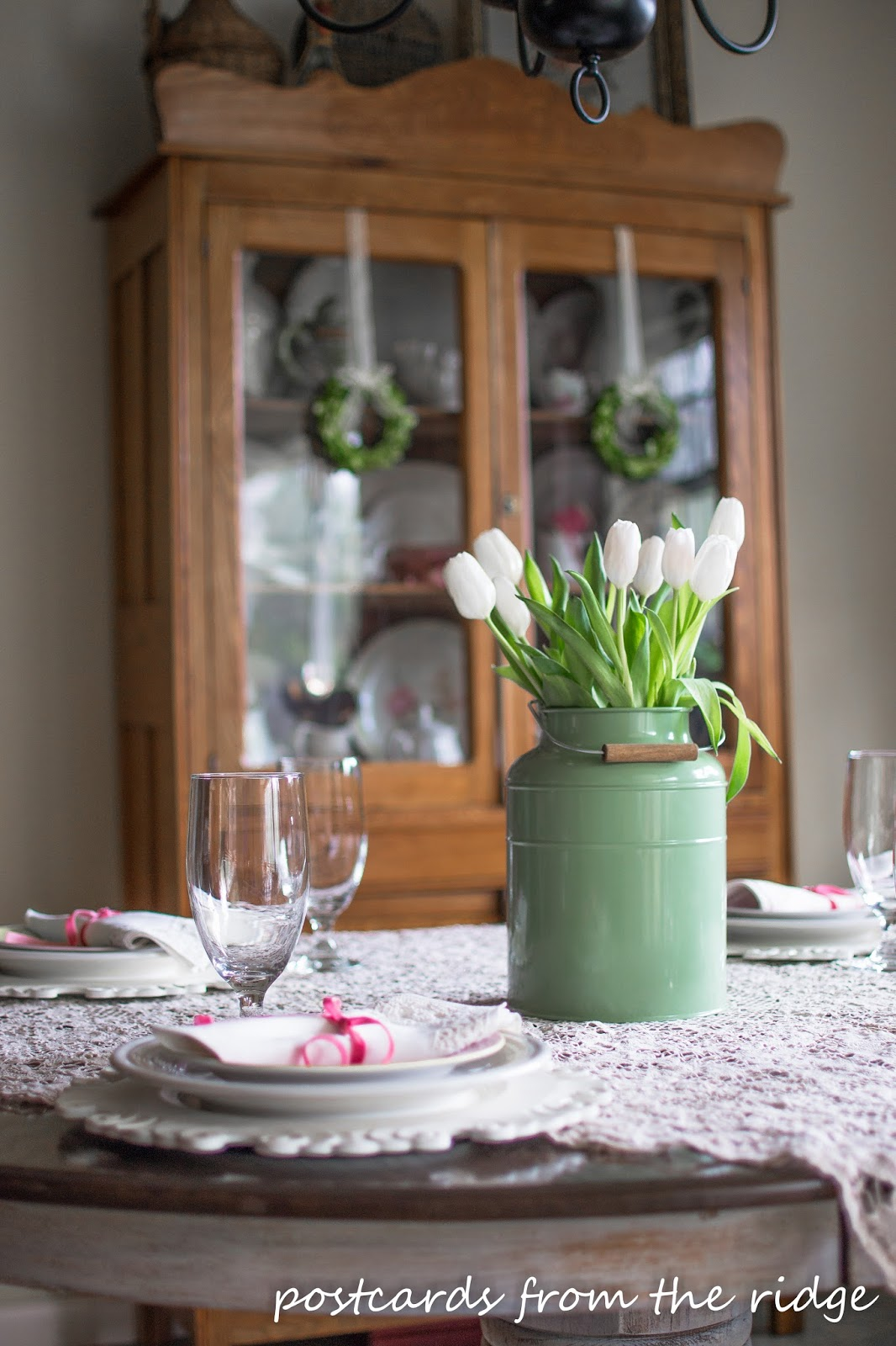 White tulips as a centerpiece for a spring table with vintage finds. Postcards from the Ridge.