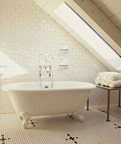 master bathroom with mosaic tiles, a claw foot stand alone tub and floor to ceiling white subway tiles