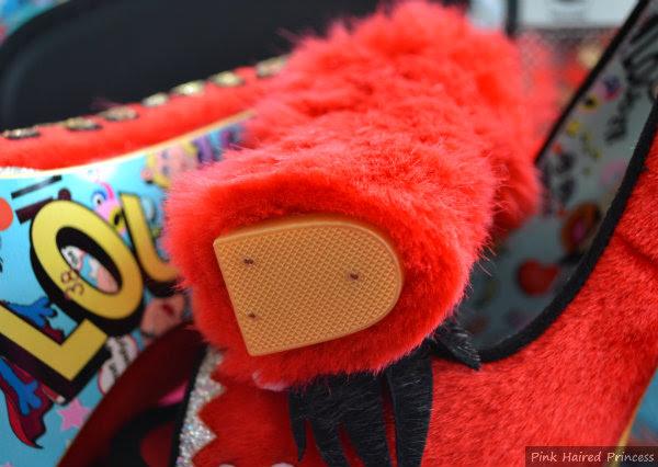 close up of heel tip on furry heel of shoe
