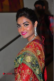Model Sharon Fernandes Stills in Red Saree at Trendz Exhibition Launch  0034.JPG