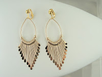 http://www.thecliponearringstore.com/day-at-the-outside-market-goldtone-clip-on-earrings.html