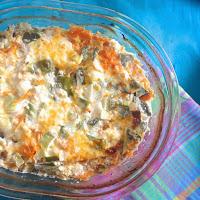 Salmão no forno com curgete, alho francês, cenoura e queijo