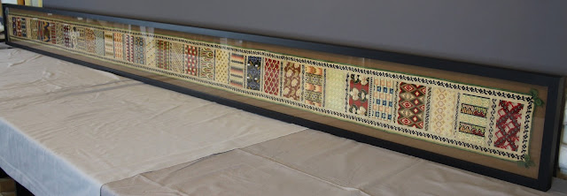 Textile conservation of Berlin work sampler featuring Bargello needlework. Conservator Gwen Spicer of Spicer Art Conservation custom mounted the unusually sized textile sampler