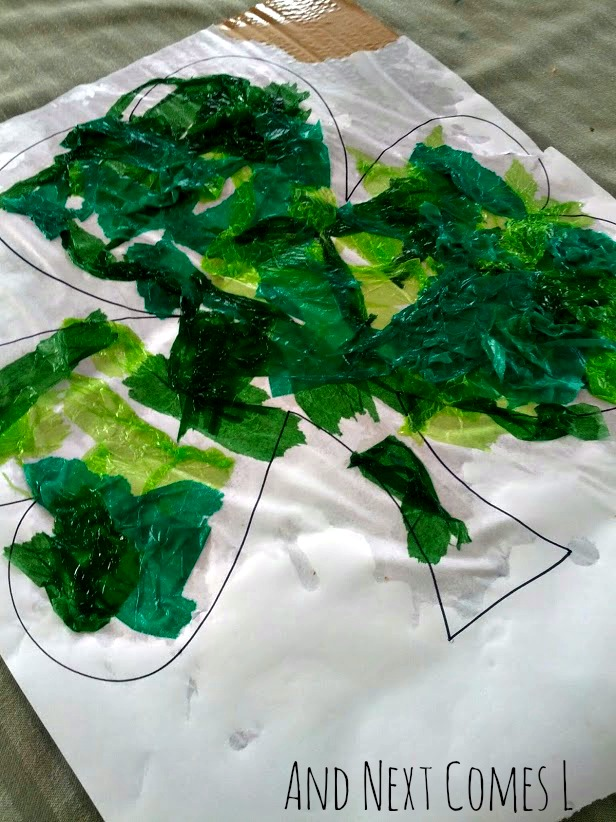 Close up of bleeding tissue paper art technique on a St. Patrick's Day craft from And Next Comes L