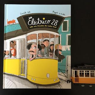 Electrico 28, Bilderbuch von Davide Cali, Illustrationen von Magali le Huche, erschienen im Knesebeck Verlag, Rezension von Kinderbuchblog Familienbücherei, lustiges Bilderbuch über Lissabons berühmte Strassenbahn (Tram) und über die Liebe