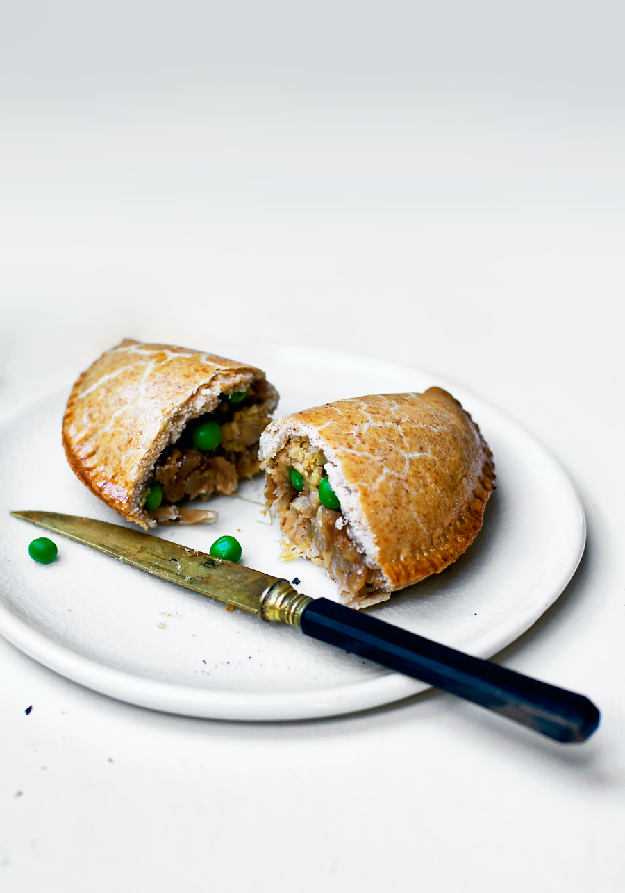 Vegan pasties filled with leeks, caramelized onion, and green peas. Pasties are a traditional Cornish pastry recipe, with savoury filling enclosed in pastry. This vegan version uses a coconut oil spelt mix for the pastry and a very nontraditional filling that I imagine adamant traditionalists would frown at - it's a modern, plant based interpretation!