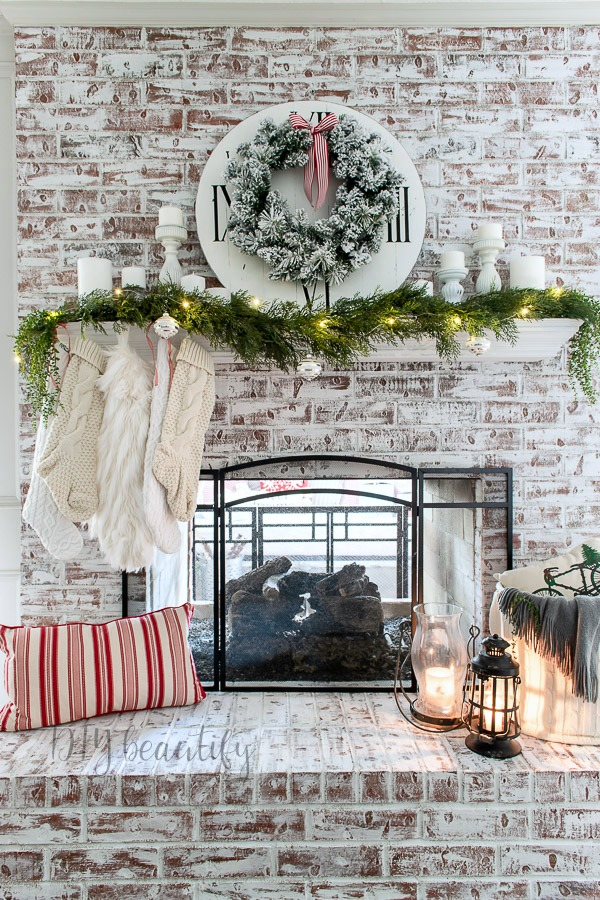 painted fireplace and neutral Christmas mantle