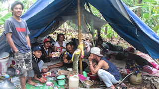 Indonesians seeks shelter in mountains as Villagers set up makeshift camps on mountainside  in fear another tsunami hittin their homes again.