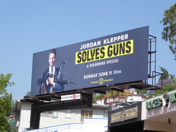 Jordan Klepper Solves guns billboard