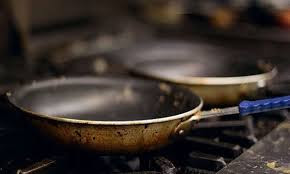 effectively clean burnt pan