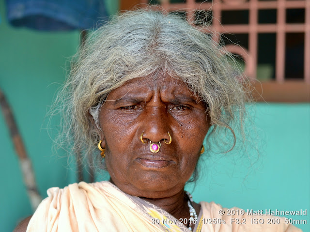tribal; Adivasi; Christian; Matt Hahnewald Photography; Facing the World; photography; photo; image; face perception; physiognomy; psychological; grey hair; educational; outstanding; favourite; superior; interesting; Nikon D3100; Nikkor AF-S 50mm f/1.8G; prime lens; 50mm lens; 4 : 3 aspect ratio; horizontal format; street; portraiture; portrait; closeup; headshot; seven-eighths view; brown; outdoor; colour; cultural; character; personality; real people; human head; human face; human eyes; nose; facial expression; eye contact; bareheaded; consent; empathy; rapport; respect; encounter; relationship; ethnic portrait; Kuvi Kondh tribe; Upper Bombu; Orissa; East India; one person; female; posing; authentic; earrings; villager; old woman; nose jewellery; nose ring; tradition