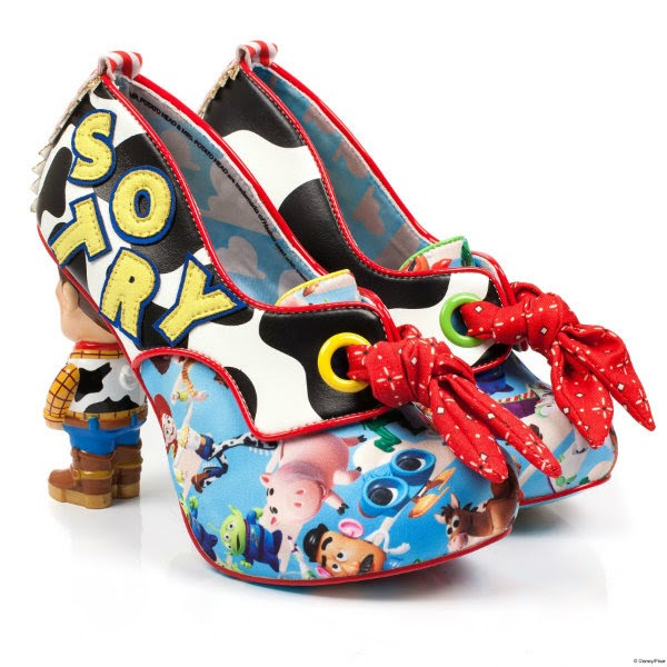 pair of Irregular Choice Toy Story shoes with blue character printed uppers, red bandana laces, cow print and Woody and Buzz heels