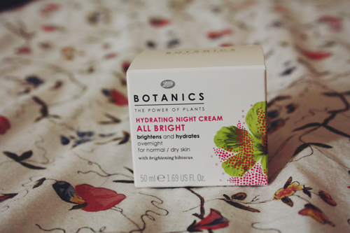 Botanics All Bright Hydrating Night Cream in its packaging on an IKEA duvet