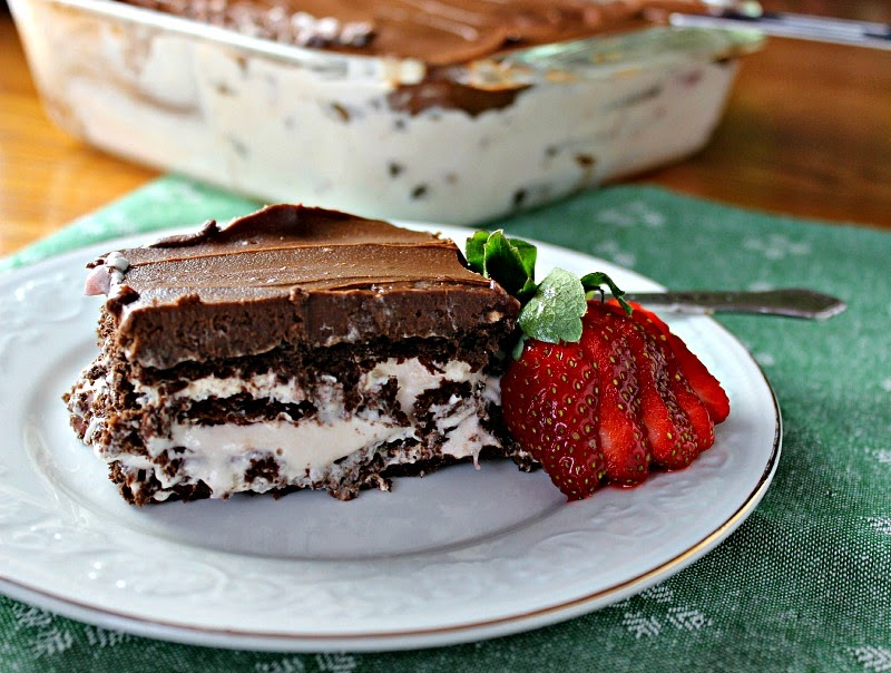 Chocolate-Strawberry Eclair Cake piece on plate with strawberry garnish