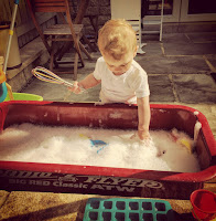 water and washing up liquid play outside