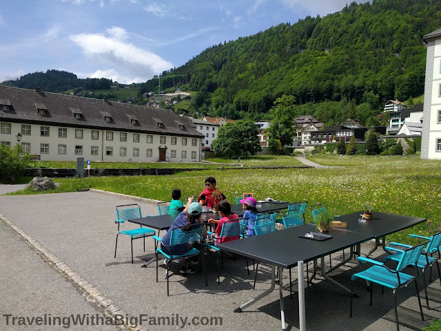 Visiting the Kloster cheese factory in Engelberg, Switzerland with a big family