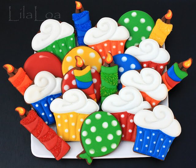 Decorated birthday sugar cookies -- cupcakes, balloons, and candles