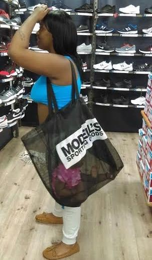 Dafuq? Woman puts her baby inside transparent bag while shopping